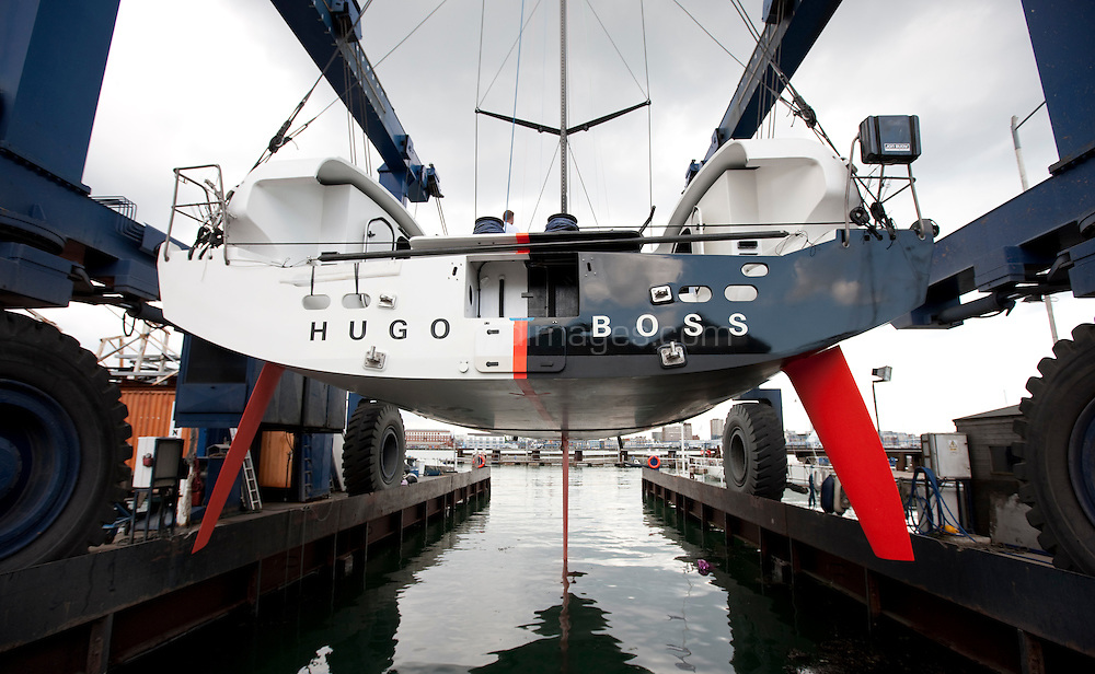 8th May  2010. Portsmouth . UK..Pictures of the new Hugo Boss IMOCA Open 60. Shown here as the complete yacht touches the water for the first time in its new configuration today