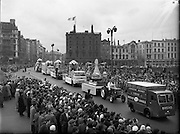 St. Patrick's Day - N.A.I.D.A. Queen of the Plough, Mary Shanahan parades through O'Connell Bridge, Dublin, Ireland, looking down  River Liffey in Dublin, and joining O'Connell Street to D'Olier Street, Westmoreland Street and the south quays. <br />