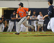 Auburn's Ryan Jenkins (6) scores on a wild pitch by Mississippi's Jordan Cooper during a college baseball in Oxford, Miss. on Friday, May 21, 2010. (AP Photo/Oxford Eagle, Bruce Newman)