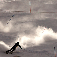 Tom Rothrock of the U.S. leaves a snow trail showing his path as he skis through the men's World Cup slalom course in Beaver Creek, Colorado December 4, 2005.  Rothrock finished in 28th position in the first heat.