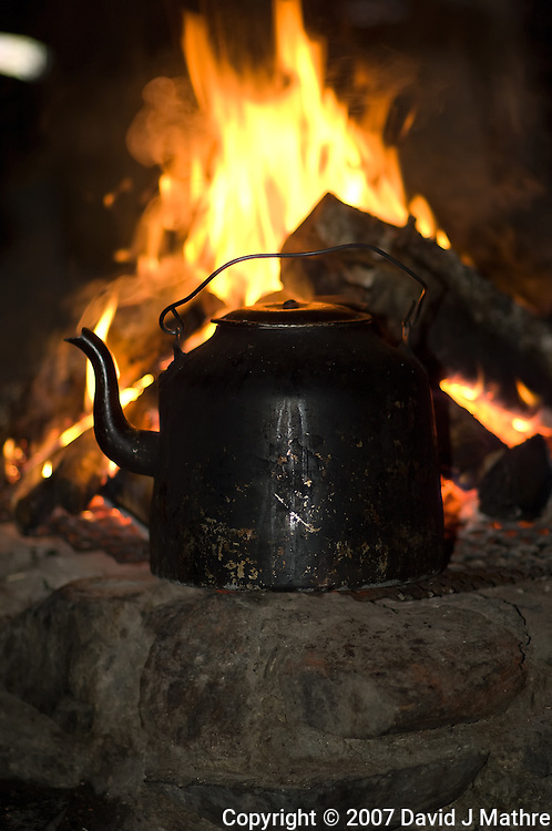 Coffee Pot on a Wood Fire. Image taken with a Nikon D2xs and 85 mm f/1.4D lens (ISO 200, 85 mm, f/1.4, 1/60 sec) and fill flash.