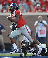 Mississippi running back I'Tavius Mathers (5) scores on a 10 yard run past Southeast Missouri State's Cantrell Andrews (24) at Vaught-Hemingway Stadium in Oxford, Miss. on Saturday, September 7, 2013. (AP Photo/Oxford Eagle, Bruce Newman)