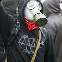 A gas masked protester demonstrates against the U.S. was in Iraq in front of the White House on February 4, 2006.