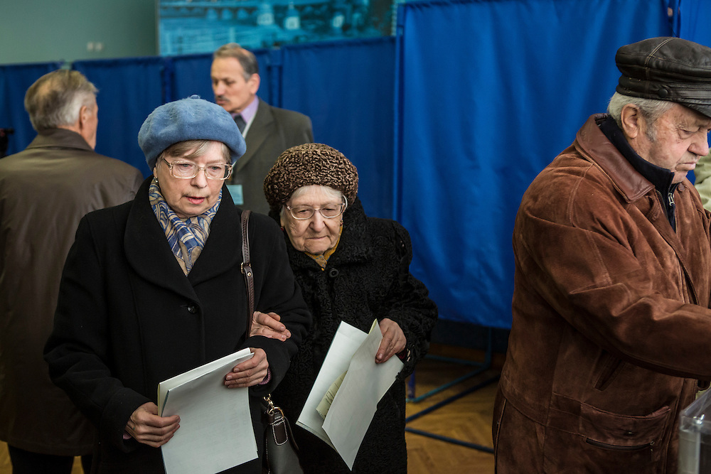 KIEV, UKRAINE - OCTOBER 26: Women prepare to cast their ballots for parliamentary elections at a polling station on October 26, 2014 in Kiev, Ukraine. The country's parliamentary elections are seen as key to President Petro Poroshenko's ability to advance his agenda. (Photo by Brendan Hoffman/Getty Images) *** Local Caption ***