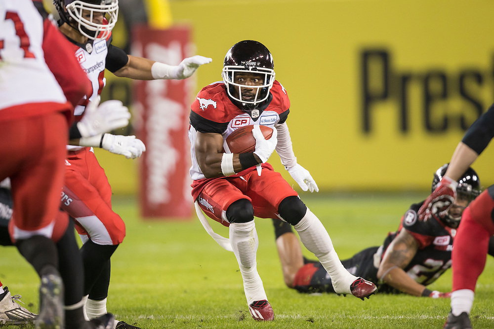 Roy Finch of the Calgary Stampeders runs the ball during the 1st quarter of the 104th Grey Cup against the Ottawa Redblacks in Toronto Ontario, Sunday,  November 27, 2016.  (CFL PHOTO - Geoff Robins)