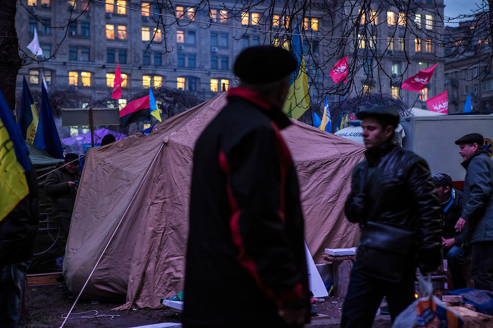 KIEV, UKRAINE - DECEMBER 5: Pedestrians walked past tents set up by anti-government protesters in Independence Square on December 5, 2013 in Kiev, Ukraine. Thousands of people have been protesting against the government since a decision by Ukrainian president Viktor Yanukovych to suspend a trade and partnership agreement with the European Union in favor of incentives from Russia. (Photo by Brendan Hoffman/Getty Images) *** Local Caption ***