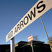 Sign showing visitors to offices and hangar of the 'Red Arrows', Britain's Royal Air Force aerobatic team at RAF Scampton
