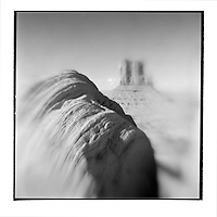 USA, Arizona, Monument Valley Navajo Tribal Park, Blurred black and white image of eroded sandstone and Mitten formation in Monument Valley