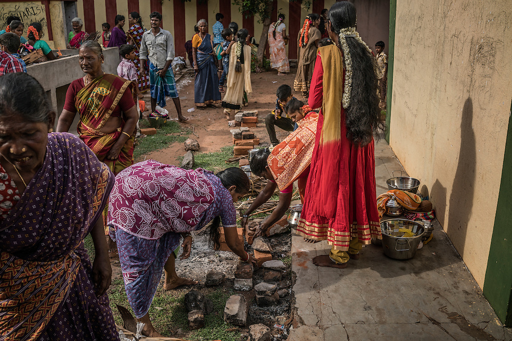 Local women prepare fire pits in which they well prepare a special meal for the Ganesh Chaturthi Festival. Chinna Mudaliyar Chavady, Tamil Nadu, India.