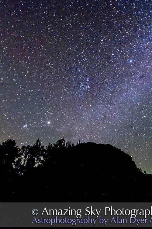 "Orion and the ""winter"" constellations of the northern hemisphere, seen here upside down as seen from the southern hemisphere, in this case Australia in December 2012, austral summer. Jupiter is the bright object at lower left in Taurus. They are over Timor Rock near Coonabarabran, NSW. This is a single exposure of 1 minute, at ISO 3200 with the Canon 60Da and 10-22mm lens at f/3.5."