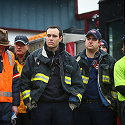 Rescue workers and volunteers outside the Darrington Fire Department pause during a state-wide moment of silence to honor the victims of the Oso mud slide one week earlier. Photographed on Saturday, March 29, 2014. (Joshua Trujillo, seattlepi.com)