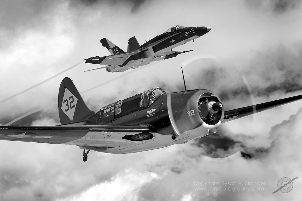 """To commemorate the 100th Anniversary of Naval Aviation, an F/A-18C Hornet takes on the colors of a WWII Helldiver unit and joins the world's only airworthy Helldiver in the skies above Central California. The F/A-18C is flown by VFA-122's LT Alex """"Scribe"""" Armatas and the Helldiver is piloted by Mark Allen."""