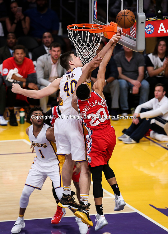 Los Angeles Lakers center Ivica Zubac (#40) blocks a shot by Philadelphia 76ers guard Timothe Luwawu-Cabarrot (#20) during an NBA basketball game Tuesday, March 12, 2017, in Los Angeles. <br /> (Photo by Ringo Chiu/PHOTOFORMULA.com)<br /> <br /> Usage Notes: This content is intended for editorial use only. For other uses, additional clearances may be required.