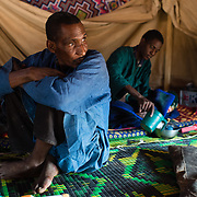 Members of a refugee family in a makeshift tent at the Mbera camp for Malian refugees in Mauritania on 2 March 2013.