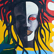 Painted sign of Rastafarian face.