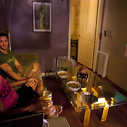 Wendall Cooper, 27, and Joshua Scanlan, 31, enjoy dinner together inside their home in Brooklyn, N.Y., Sept. 16, 2011.