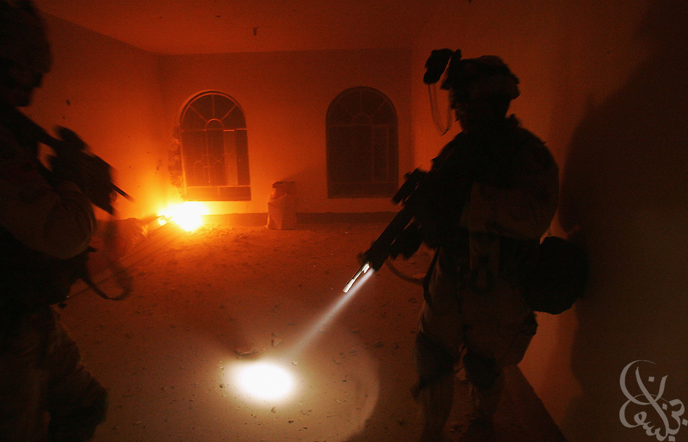 U.S. Army soldiers from the 1st Infantry Division's 2nd Battalion-2nd Regiment sweep through an abandoned home during heavy fighting November 09, 2004 in the Iraqi insurgent stronghold of Fallujah.