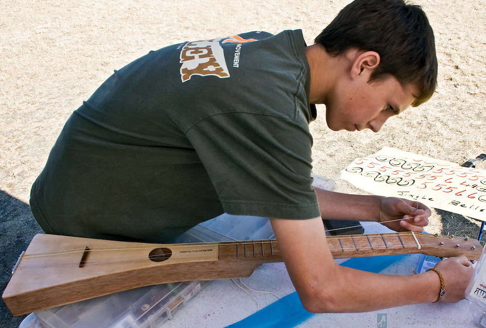 Boy making a guitar at an Andy Mackie Music Foundation event during the 2009 American Fiddle Tunes Festival at Fort Worden in Port Townsend, Washington.