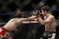 Dec 12, 2009; Memphis, TN, USA; Lightweights Kenny Florian and Clay Guida during their bout at UFC 107 at the FedEx Forum in Memphis, TN.  Florian won via rear naked choke in the 2nd round.