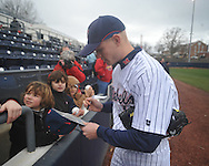 Former Ole Miss baseball player Jordan Henry signs autographs at the Ole Miss baseball alumni game at Oxford-University Stadium in Oxford, Miss. on Saturday, February 5, 2011.