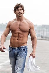 shirtless muscular man walking