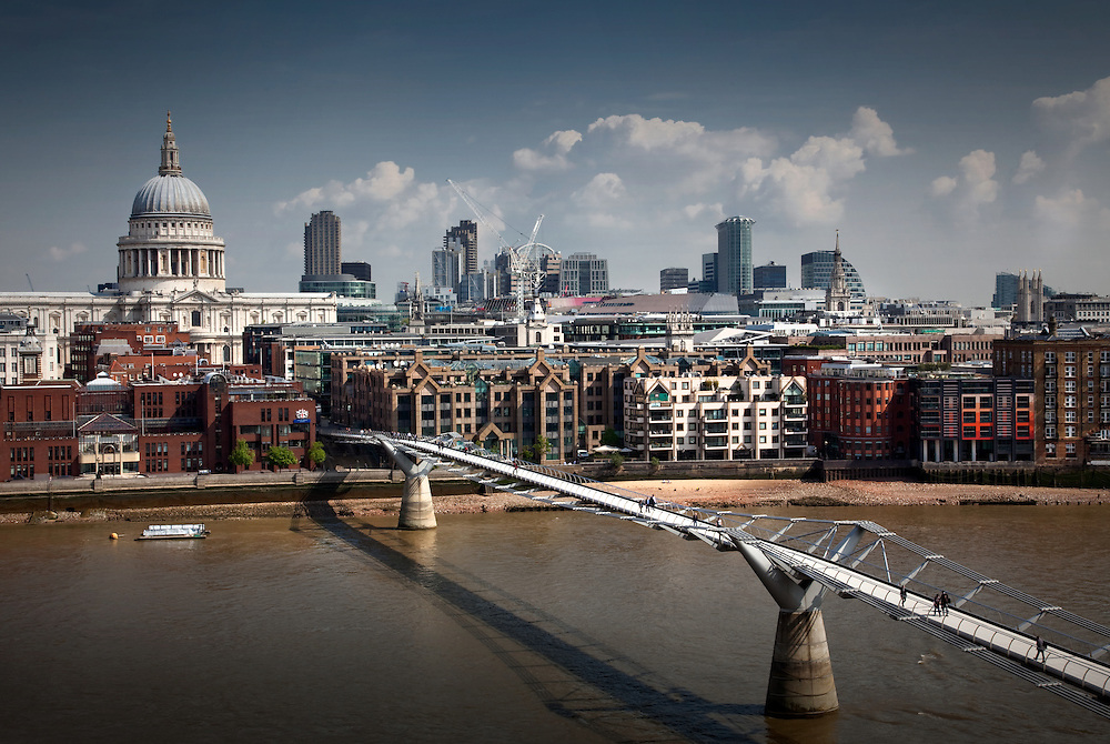 Millenium Bridge over the Thames in London with St. Pauls in the Background.