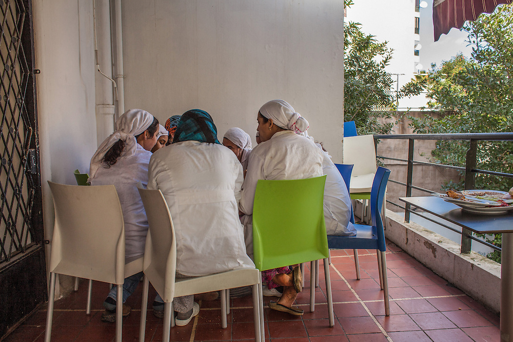 """Casablanca, March 2015. All the girls helped by the association """"Solidarité feminine"""", have the opportunity to work in the restaurant and hammam created by the will of the founder Aicha Ech-Channa. In this image the girls all have lunch together, after finishing work at the restaurant."""