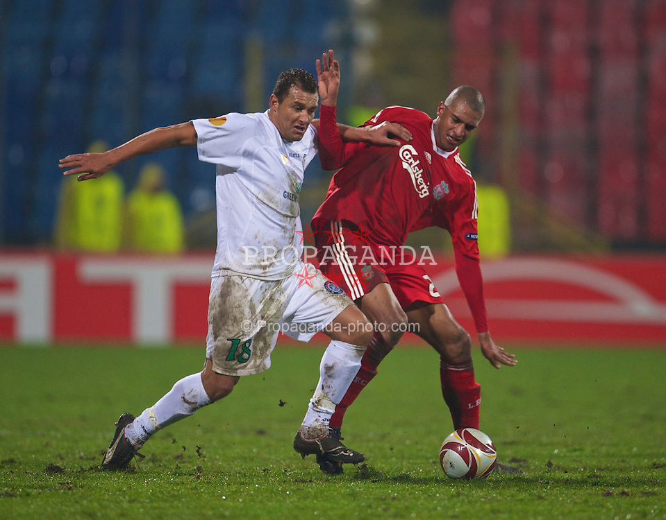 BUCHAREST, ROMANIA - Thursday, February 25, 2010: Liverpool's David Ngog and FC Unirea Urziceni's Ricardo Vilana during the UEFA Europa League Round of 32 2nd Leg match at the Steaua Stadium. (Photo by David Rawcliffe/Propaganda)