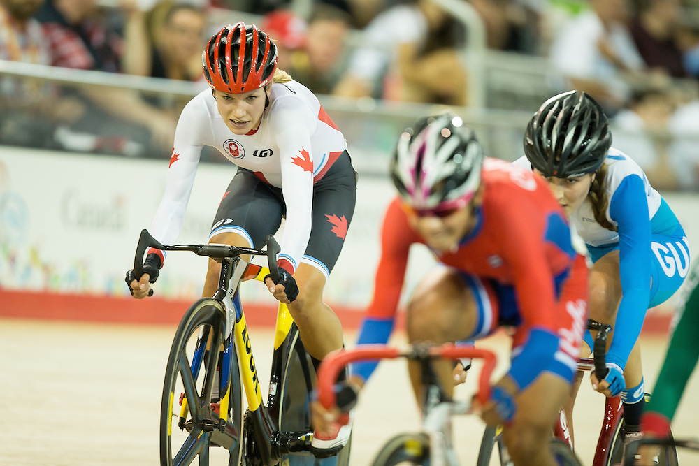 Jasmin  Glaesser (L) of Canada competes women's cycling omnium points race at the 2015 Pan American Games in Toronto, Canada, July 19,  2015.  AFP PHOTO/GEOFF ROBINS