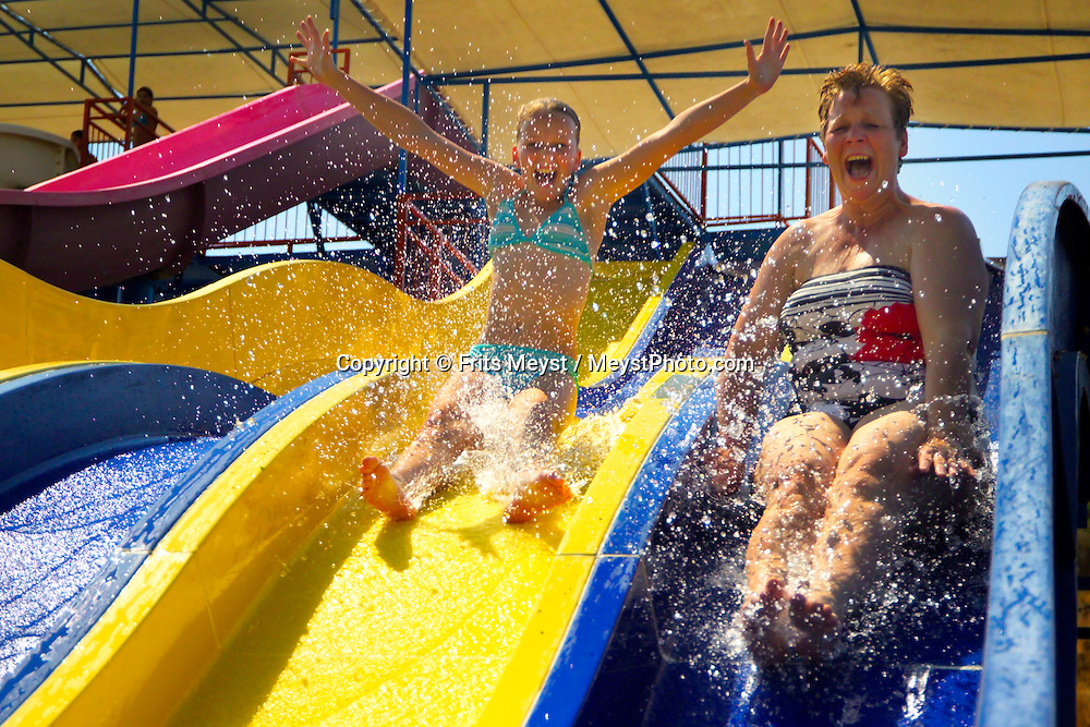 Bodrum, Turkey, July 2004. Family fun on the waterslide near Bodrum.  Photo by Frits Meyst/Adventure4ever.com