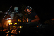 Portuguese FPU ( Formed Police Unit) patrolling the Dili streets at night after the shooting incidents early Monday Morning in which the President Jose Ramos-Horta was shot and wounded and a number of others killed or injured. The convoy of the Prime Minister Xanana Gusmao was also attacked but not injured. @ UNMIT/Martine Perret. 11 February 2008