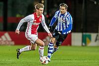 AMSTERDAM - Jong Ajax - FC Eindhoven , Voetbal , Jupiler league , Seizoen 2016/2017 , Sportpark de Toekomst , 24-02-2017 , Jong Ajax speler Frenkie de Jong  (l) in duel met Eindhoven speler Mart Lieder (r)