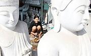 Marble carvers and Buddha statues. Mandalay, Myanmar