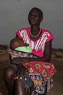 Mary Albunu holds Baby Robert Tikai  five month, as she attends a mother to mother group at Manyatta Zebra, Isiolo county, Kenya Thursday, Feb. 13, 2014. The mother-to-mother support group in the village of Manyatta Zebra  teach women about hygiene and sanitation, nutrition, how to breastfeed, the importance of going to antenatal check-ups and delivering in hospital. Just as important it has generated a sense of community  and solidarity in the town's child bearing women and created an exchange of information  and knowledge between mothers.