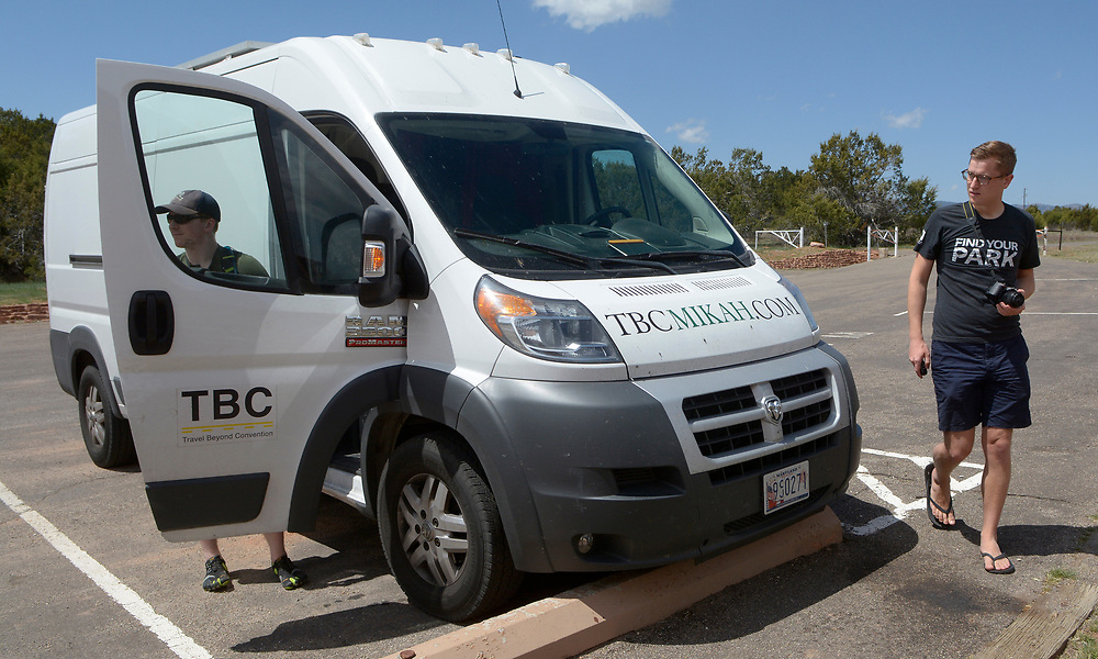 gbs041217d/STATE -- Mikah Meyer of Lincoln, Nebraska, right, with college friend, Tim Logan of Vancouver, Canada  get out of his van at the Quarai ruins of the Salinas Pueblo Missions National Mounument on Wednesday, April 12, 2017. Meyer is living in his van while on his journey.(Greg Sorber/Albuquerque Journal)