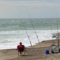 NC00595-00...NORTH CAROLINA - Surf fishing at Fort Fisher State Recreation Area.