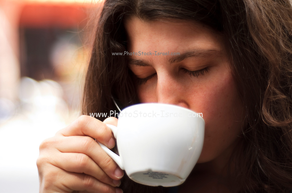 Young woman drinking coffee - Model release available