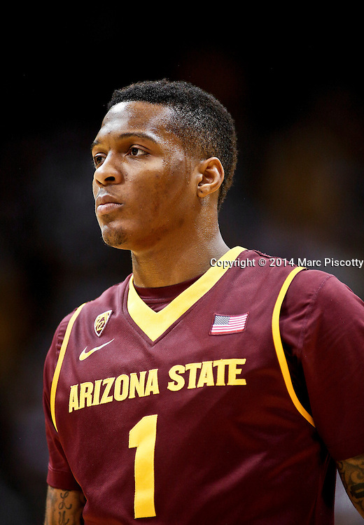 SHOT 2/19/14 10:27:52 PM - Arizona State's Jahii Carson #1 during a break in the action in their regular season Pac-12 basketball game against Colorado at the Coors Events Center in Boulder, Co. Colorado won the game 61-52.<br /> (Photo by Marc Piscotty / &copy; 2014)