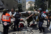 Israeli emergency workers evacuate wounded from a home that was directly hit a Hizbollah rocket in the coastal city of Haifa July 17,2006. Numerous rockets hit the city and other areas of northern Israel. (Photo by Heidi Levine/Sipa Press).