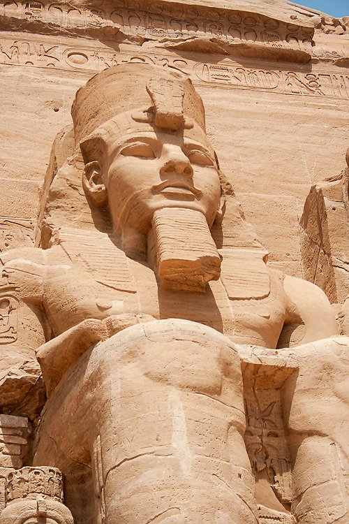 """The Abu Simbel temples are two massive rock temples in Abu Simbel  in Nubia, southern Egypt. They are situated on the western bank of Lake Nasser, about 230 km southwest of Aswan. The complex is part of the UNESCO World Heritage Site known as the """"Nubian Monuments"""" which run from Abu Simbel downriver to Philae (near Aswan)."""