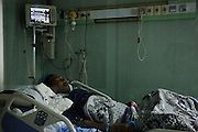An Egyptian man recovers after a liver transplant  at the National Liver Institute in downtown Cairo, Egypt June 10, 2015. The Institute began treating Hepatitis C patients with direct-acting antiviral sofosbuvir last year as part of a large scale program that eventually hopes to lower Hepatitis C rates from 15% in Egypt down to just 2% within a decade. (Photo by Scott Nelson, for the New York Times)