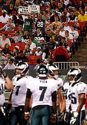 Sept 3, 2009; East Rutherford, NJ, USA;  New York Jet fans hold up signs directed at Philadelphia Eagles quarterback Michael Vick (7) during the second half at Giants Stadium.  The Jets defeated the Eagles 38-27.