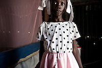 An old face on a young girl in a tented camp in Port au Prince, Haiti