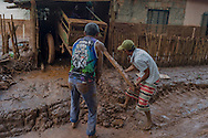 Two men working in order to release a carriage jammed in the mud in Paracatu de Baixo, one of the districts of Mariana, a brazilian city in the state of Minas Gerais. On november 5th, a mining waste dam failed causing a flood of mud.