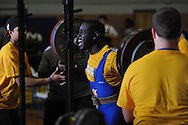 William Paine squats during Class 5A Region weightlifting competition at Oxford High School in Oxford, Miss. on Saturday, February 9, 2013.