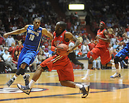 "Mississippi's Chris Warren (12) vs. Memphis' Will Coleman(10) in NIT second round basketball action at the C.M. ""Tad"" Smith Coliseum in Oxford, Miss. on Friday, March 19, 2010. Ole Miss won 90-81."