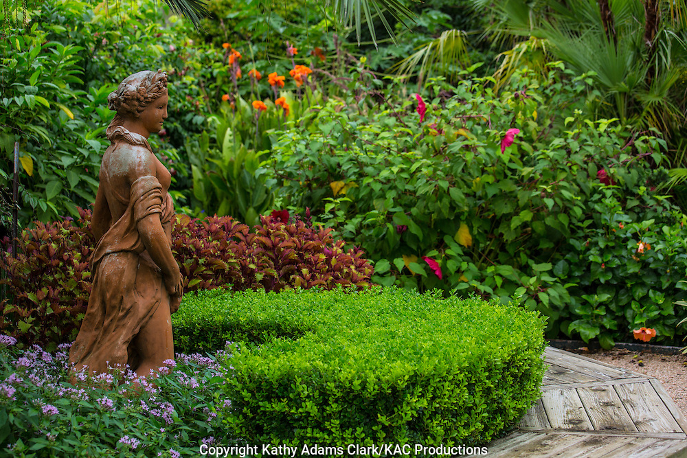 Statue of a lady, boxwood, formal garden, Garden, Houston, late summer, Texas.