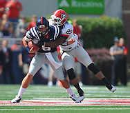 Ole Miss' Zack Stoudt (8) is tackled by Georgia linebacker Jarvis Jones (29) at Vaught-Hemingway Stadium in Oxford, Miss. on Saturday, September 24, 2011. Georgia won 27-13.