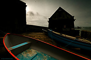 Nominated in 10th (2017) International Colour Awards (Architecture category) <br /> <br /> Now disused by the #RNLI the old Lizard Lifeboat House still stands, now houses the gear of the Lizard fishermen. It is gradually looking more dilapidated each time I visit but it will always stand as a reminder to me, at Britain&rsquo;s most Southerly point, of a place from which the bravest men risked their lives to save the lives of hundreds and hundreds of floundering souls at this notorious peninsula. <br /> <br /> To me, the red is not just the gunwale of a boat, but blood, an artery - a lifeline for the sailors against the darkness of their situation.