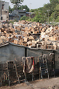 Baskets on the roof of Long Bien Market with trolleys leaning against the wall, Hanoi, Vietnam